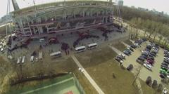 People form queues near entrance of Locomotive sports stadium Stock Footage