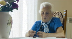 Stock Video Footage of Elderly woman praying with rosary beads, crucified Christ, cross, old