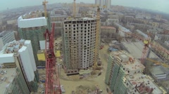 Several cranes work on building site of dwelling complex Stock Footage