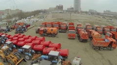 Many machines are in municipal service park. Aerial view - stock footage