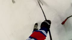 Boys try to get puck after face-off in hockey game - stock footage