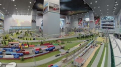 Toy train ride in model of railway station at exhibition Stock Footage