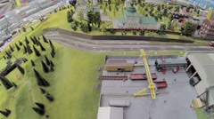Scaled model of railroad with toy freight with coal rides Stock Footage