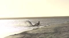 Kitesurfer into the sun in slow motion Stock Footage