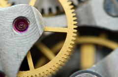 Background with metal cogwheels a clockwork. Stock Photos