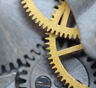 background with metal cogwheels a clockwork. macro - stock photo
