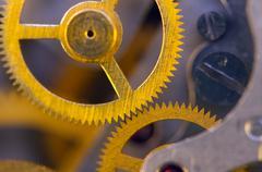 background with metal cogwheels a clockwork. - stock photo