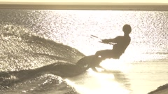 Kitesurfer into the sun in slow motion Stock Footage