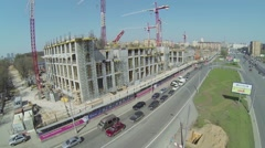 Transport ride by street near construction site of city block Stock Footage