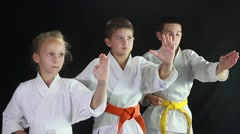Two boys and a girl in a kimono are train a punch in the air Stock Footage