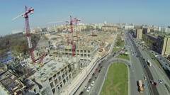 Cityscape with traffic near construction site of city block Stock Footage