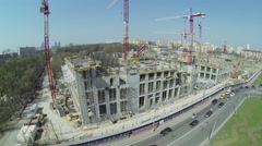 Cars ride by road near building site of city block VTB Arena Park Stock Footage