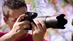 2of6 Man taking photo, amateur photographer shooting picture in park Stock Footage