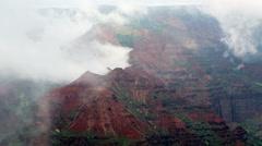 Swirling mists over Waimea Canyon Kauai Stock Footage