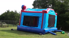 Deflating bouncy castle or moon bounce - stock footage