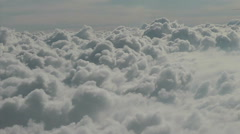 Pure High Altitude fluffy white clouds float past Stock Footage