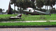 Airplane's Broken Wing And Landing Gear Fuselage Background Crash Wreckage 4K Stock Footage
