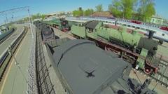 Old trains parked at Rizhsky railway station at sunny spring day Stock Footage