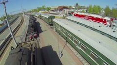 Old trains are at Rizhsky railway station at sunny spring day. Stock Footage