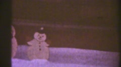 Snow and cut outs on lawn Stock Footage