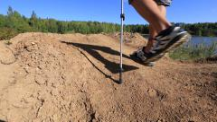 The guy walking on rough terrain Stock Footage