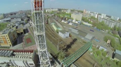 Tall tubes of boiler room near railway in city at sunny day Stock Footage