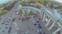 People walk near entrance gate of Russian Exhibition Complex Stock Footage