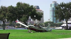 Crash Wreckage Of A Small Plane On Grass Field City Skyline In Background 4K. Stock Footage