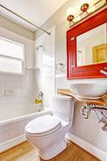 Bathroom interior. red cabinet with mirror and white vessel sink Stock Photos