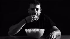 Lonely man eating pop-corn: film, night, loneliness, addiction, television, Arkistovideo