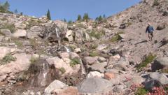 Man Descending Mountain Waterfalls Stock Footage