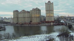 Dwelling complex Scarlet Sails on river shore at evening Stock Footage