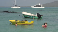 Tourists making picture close to the Sea lions sleeping on a boat in the harbour Stock Footage