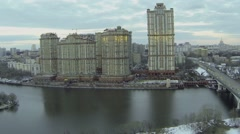 Cityscape with traffic on bridge near dwelling complex Stock Footage