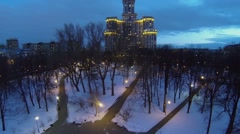 Small park with illumination near tall residential complex Stock Footage