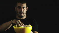 Lonely man eating pop-corn: film, night, loneliness, addiction, television, Stock Footage