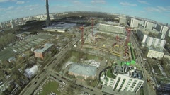 Cityscape with traffic near TV tower and construction site Stock Footage