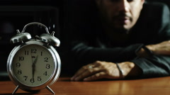 The time is out: depressed man falls whit head on the table Stock Footage