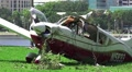 Crash Wreckage Of A Small Plane On Grass Field Close Up HD HD Footage