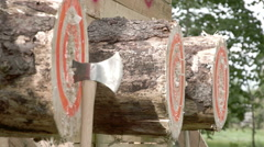 Three axes sharply landed on the logboard Stock Footage