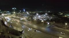City traffic near construction site of Hotel Hayat Stock Footage