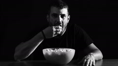 Lonely man eating pop-corn Arkistovideo