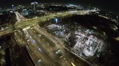 Cityscape with traffic on interchange near construction site Stock Footage