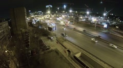 Road traffic near building site with illumination at spring Stock Footage