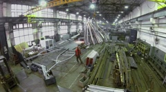 People work in large workshop of Special Automobiles Plant - stock footage