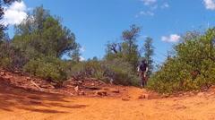 Low Angle Desert Mountain Biker Toward Camera Stock Footage