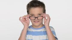 Pretty  boy of ten years, wears glasses Stock Footage