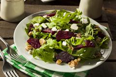 raw green beet and arugula salad - stock photo