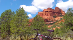 Mountain Bike Parked By Trail With Sedona Red Rocks Stock Footage