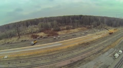 Truck and crane at building site of railway tracks among forest Stock Footage